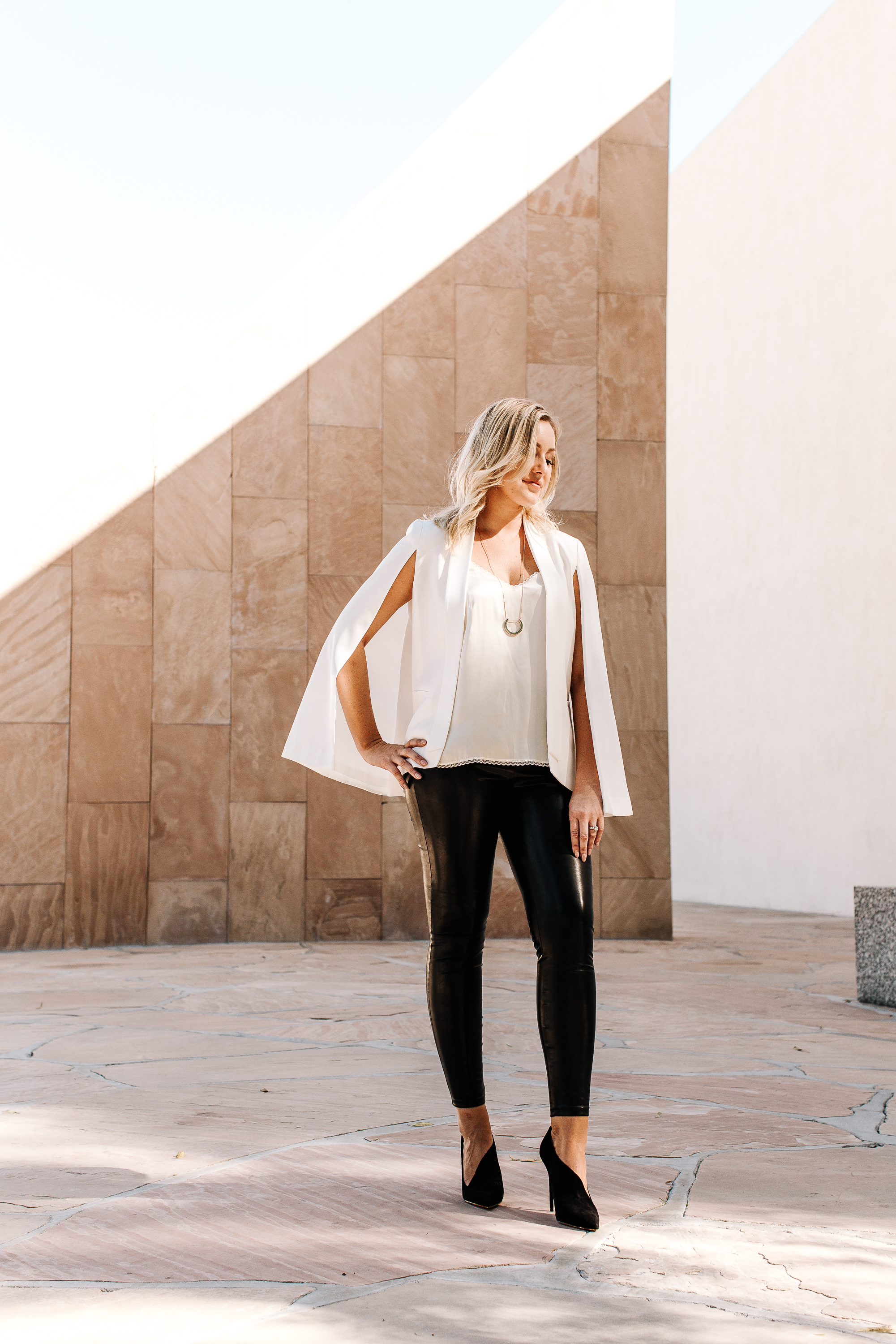 white-capelet-leather-leggings-and-silk-blouse
